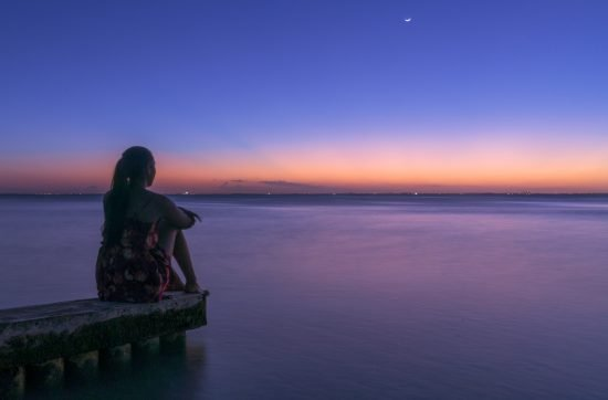 Girl looking at Sunset in the Grand Caymen